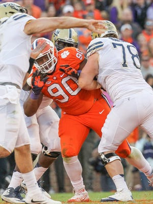 Clemson defensive lineman Dexter Lawrence (90) pressures Pitt quarterback Nathan Peterman (4) during the second quarter on Saturday at Memorial Stadium in Clemson.