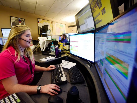 Dispatcher Kira Stammer monitors calls from her work