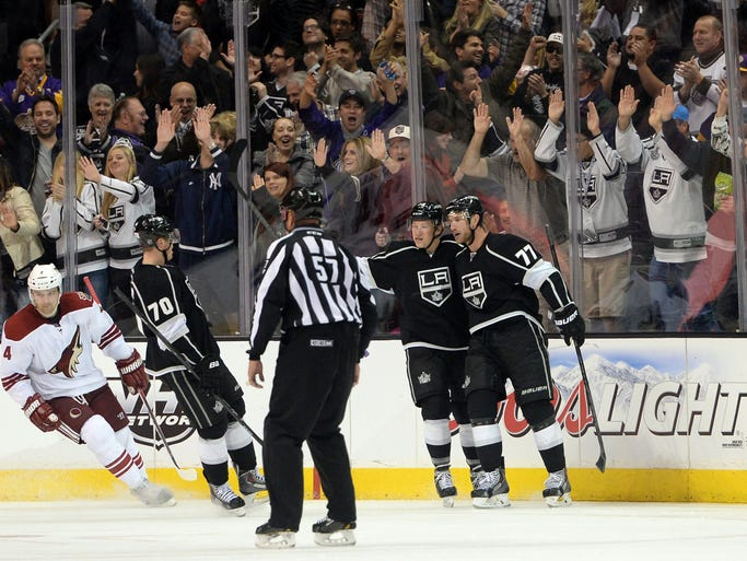 Los Angeles Kings center Jeff Carter (77),  left wing Tanner Pearson (70) and center Tyler Toffoli (73) celebrate after a goal in the third period of the game against the Phoenix Coyotes at Staples Center. Kings won 4-0.