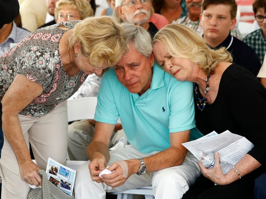 Carl Hiaasen, center, brother of Rob Hiaasen, one of