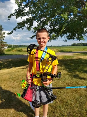 Hayden Fether, 10, of Waldron, poses with the gold medal he won at the USA Archery/Society for Archery in Michigan 2020 State Outdoor Championship in Rockford, Mich. Courtesy: Jake Fether