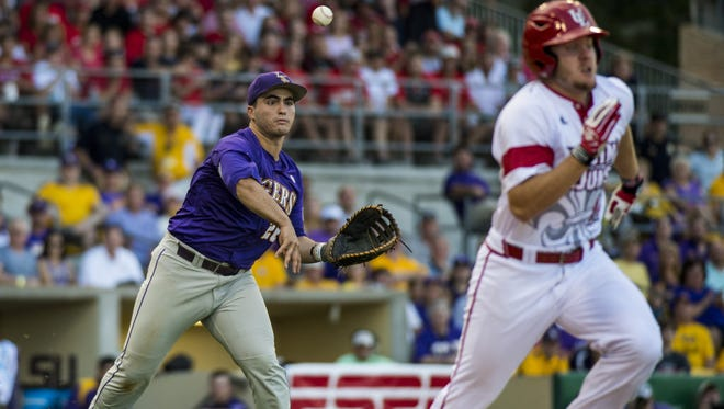 LSU Tigers catcher Chris Chinea (26) throws out UL Ragin' Cajuns infielder Joe Robbins (12) during last season's NCAA Super Regional game at Alex Box Stadium in Baton Rouge on June 7, 2015. The Tigers defeated the Cajuns 6-3 to capture the NCAA Super Regional championship and advance to the College World Series in Omaha, Nebraska.