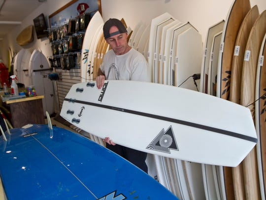 Craig Gordon, owner of Gordon's Surf Shop, shows a new shape in surfboard design he has available in his shop in Point Pleasant Beach.