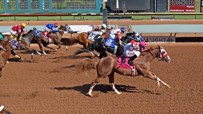 Apolltical Chad, front, won the Ruidoso Futurity on June 12 and is the morning-line favorite for Monday's $3 million All American Futurity at Ruidoso Downs.
