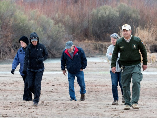 New Mexico State Parks Ranger Alex Mares and a group