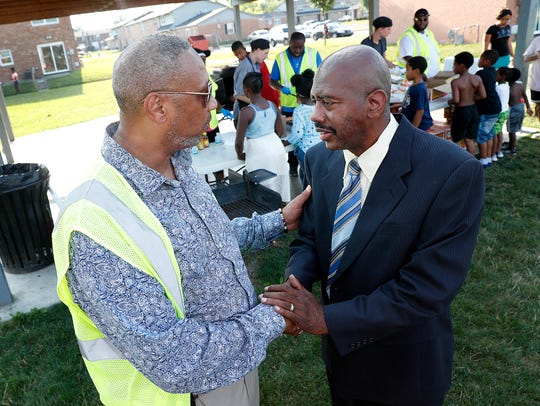 Leroy Smith, from Ten Point Coalition and  Rev. Charles