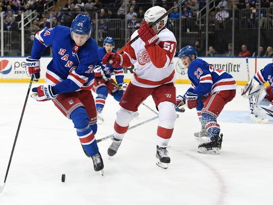 New York Rangers right wing Kaapo Kakko (24) and Detroit Red Wings center Valtteri Filppula (51) vie for the puck during the third period of an NHL hockey game, Friday, Jan. 31, 2020, in New York. (AP Photo/Sarah Stier)