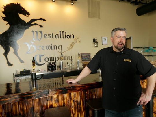Erik Dorfner, owner of Westallion Brewing Co., at 1825 S. 72nd St. in West Allis, talks about a joint fundraiser he held at the bar with two other businesses last weekend to raise money they hope will offset budget cuts of art and music in West Allis schools.