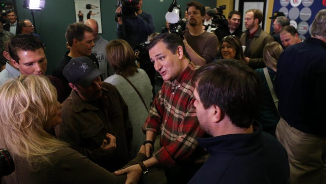 Former Sen. Ted Cruz greets supporters after speaking at the Crossroads Shooting Sports gun shop on Friday, Dec. 4, 2015, in Johnston, Iowa.