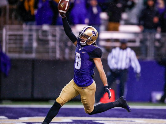 Washington Huskies wide receiver Dante Pettis (8) celebrates after catching a touchdown pass against the Oregon Ducks during the third quarter at Husky Stadium.