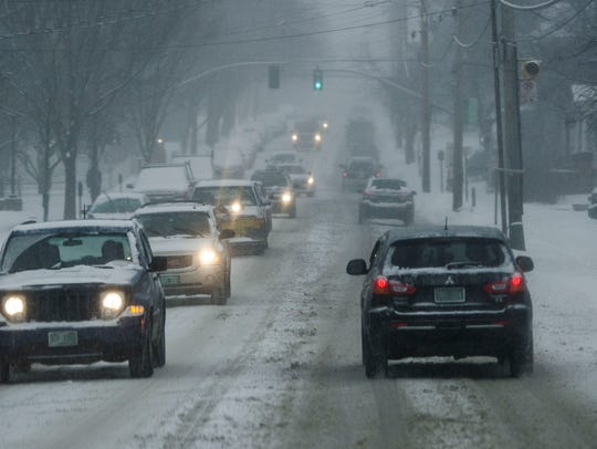 Cars take it slow coming down Pearl Street in Burlington