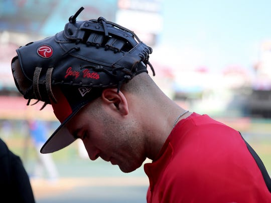 Cincinnati Reds first baseman Joey Votto (19) signs an autograph before a National League baseball game between the New York Mets and the Cincinnati Reds, Monday, May 7, 2018, at Great American Ball Park in Cincinnati.