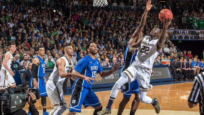 Notre Dame guard Jerian Grant  goes up for a shot as Duke Blue forward Justise Winslow defends in the second half at the Purcell Pavilion.