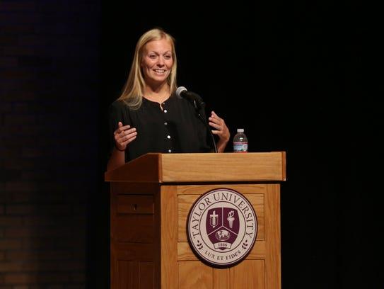 Whitney (Cerak) Wheeler addresses a crowd during a