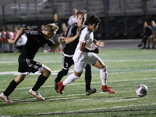 Gulf Coast forward Sebastian Joffre beats Braden River defenders to make it into the box during the Class 4A-Region 3 quarterfinal match between Gulf Coast and Braden River on Wednesday. Gulf Coast advances to the semifinal on Saturday night after a 4-0 win over the Pirates.
