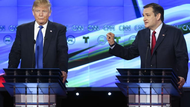 Donald Trump and Sen. Ted Cruz participate in the Republican presidential debate at the Moores School of Music at the University of Houston.