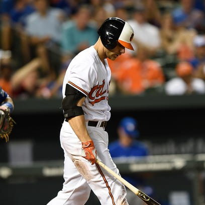 Baltimore Orioles' Chris Davis reacts after striking