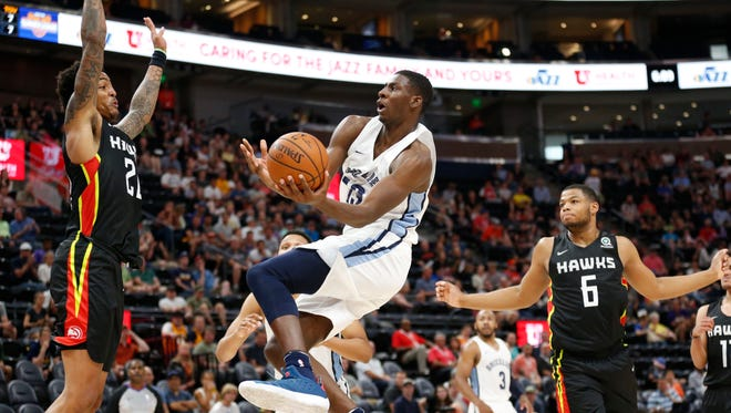 Memphis Grizzlies' Jaren Jackson Jr. goes to the basket against Atlanta Hawks' John Collins in the second half of an NBA summer league game Monday, July 2, 2018, in Salt Lake City.