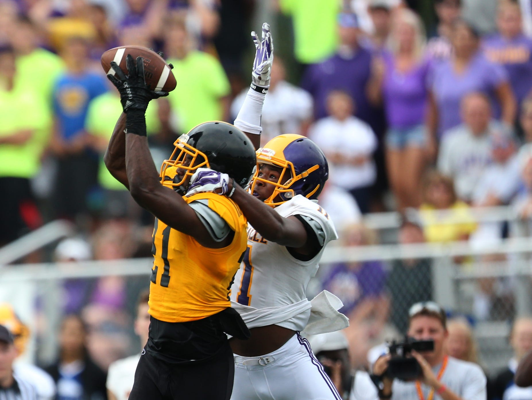 Detroit Martin Luther King's Lavert Hill makes the game-saving interception in front of Warren De La Salle's Myles Charlie during the Prep Kickoff Classic on Aug. 29, 2015 at Wayne State's Tom Adams Field in Detroit.
