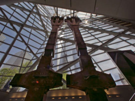 A pair of World Trade Center tridents, that once formed part of the exterior structural support of the east facade of the building, are displayed at the National Sept. 11 Memorial Museum, Wednesday, May 14, 2014, in New York. (AP photo)