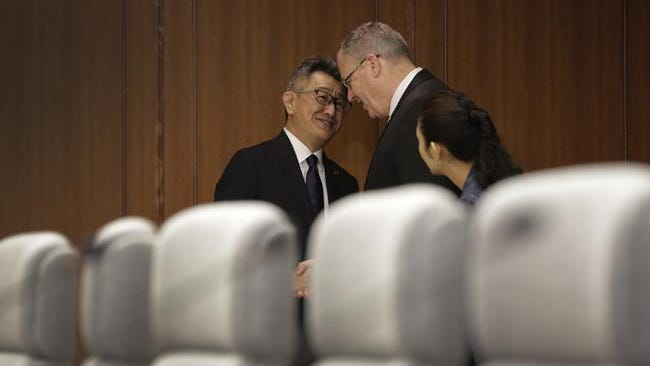 Robert Work, right, and Japanese counterpart Ryota Takeda, left, chat prior to their meeting at the Japanese Ministry of Defense in Tokyo on Aug. 22, 2014.