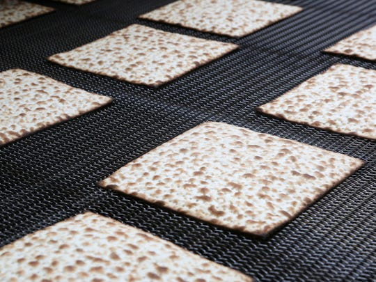 Matzo moves along the production line at Streit's matzo