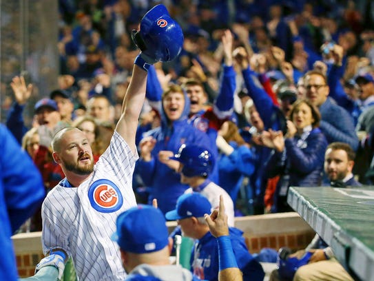 Travis Wood acknowledges fans with a curtain call.