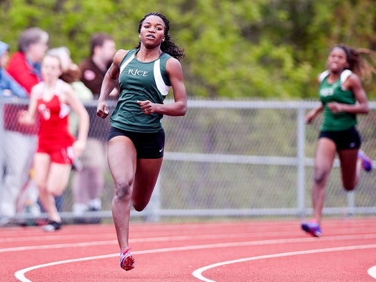 Rice's Sonia John rounds the final turn en route to winning the girls 400 meters at the Burlington Invitational track meet on May 13, 2017, at D.G. Weaver Athletic Complex.