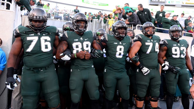 MSU's linemen outweigh Air Force's lines considerably. Will the Spartans' touted fronts be the difference Saturday?