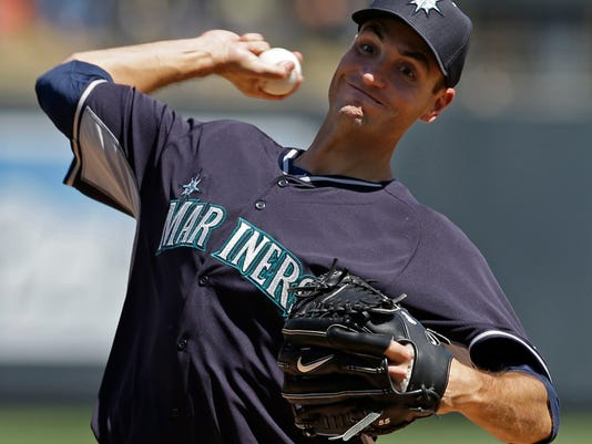 Seattle Mariners' Chris Young throws before the third inning of a spring exhibition baseball game against the Colorado Rockies on Saturday, March 29, 2014, in Scottsdale, Ariz. (AP Photo/Darron Cummings)