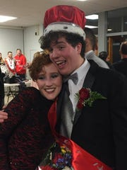 Newly crowned Mr. Vineland Jacob Kell hugs his twin