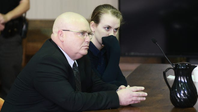 Emile Weaver listens as the verdict is read in her aggravated murder trial in Muskingum County Common Pleas Court on Friday. Weaver was found guilty of aggravated murder in the death of her infant daughter.