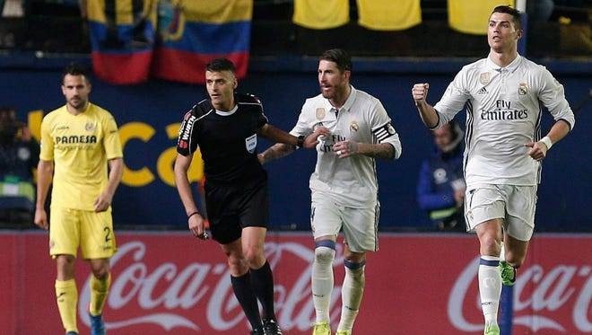 Cristiano Ronald (right) celebrates after scoring against Villarreal.