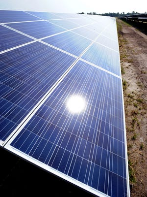 Solar panels in Georgetown absorb sunlight. Power plants will have to cut emissions by 32 percent by 2030 under a White House plan.