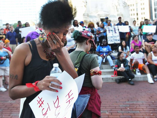 Januarie York, Indianapolis is overcome by emotion following the moment of silence. The Nationwide Moment of Silence to protest brutality by police was observed with a gathering on Monument Circle Thursday August 14, 2014.