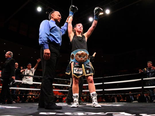 Jennifer Han is declared the winner over Lizbeth Crespo in a hard fought bout Saturday night in the Don Haskins Center.