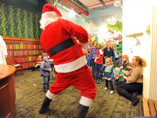 Santa gets into the groove at the Mississippi Children's Museum.