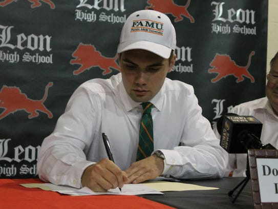 Leon High kicker Donovan Doud signs his Letter of Intent