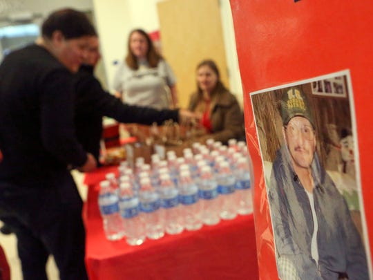 A photo of Carmen DiLuzio looks out from a display during distribution of gift bags to truckers in his memory at the Delaware Welcome Center Saturday.