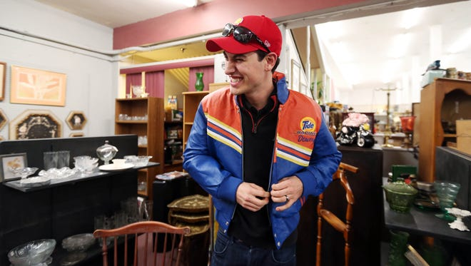 Joey Logano tries on an old Tide Racing jacket while shopping for antiques in Daytona Beach, Fla.