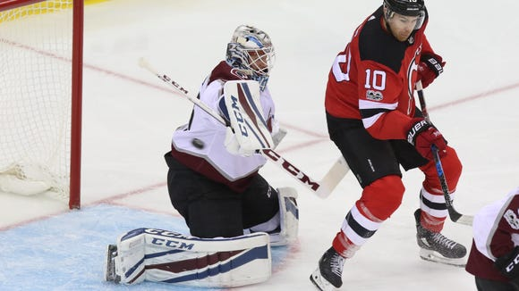 Colorado goalie Jonathan Bernier makes a save on a deflection by Jimmy Hayes of the Devils in the first period.