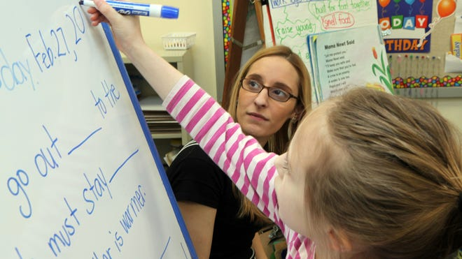 Student teacher Samantha Felder works with first-grader Shea Hollwedell at the Park Avenue School in Port Chester on Feb. 27. Felder is completing a master's degree at Manhattanville College and is preparing for the new edTPA exam in order to get her initial certification to teach in New York state.