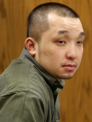 Chong Leng Lee, 30, during opening statements in Outagamie County Circuit Court  on Feb. 25, 2016 in Appleton, Wisconsin. Lee is charged with first-degree intentional homicide with a dangerous weapon, soliciting perjury and four counts of being party to the crime of witness intimidation in the 2013 shooting death of Joshua Richards, 25, of Green Bay, at the now-closed Luna Lounge nightclub in downtown Appleton.
