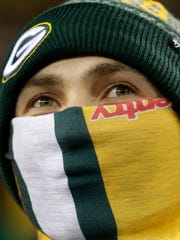 Fans bundled up to fight the cold during the Packers-Bears game at Lambeau Field.