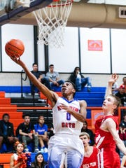 Central High School's Jesse Scott tries to make a layup against Belton at Babe Didrikson Gym on Tuesday, Jan. 9, 2018.