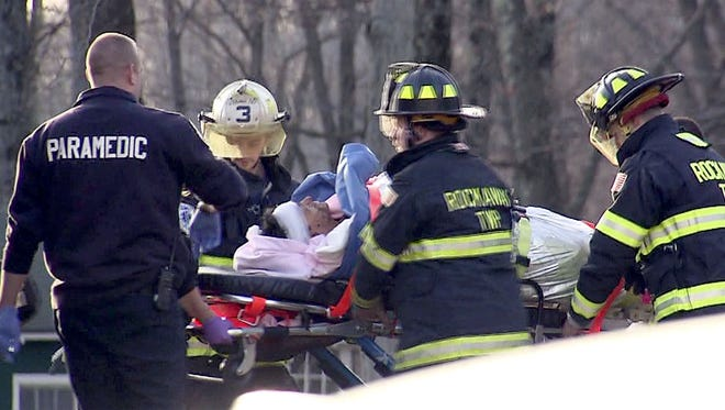 Scoutmaster Christopher Petronino, 50, of Boonton, is moved to a medevac helicopter after he was bitten and cornered in the cave in Rockaway Township for more than an hour before three Boy Scouts lured the animal out of the cave with food, according to NJDEP Press Director Bob Considine. 12/20/15 ~IMAGE COURTEY OF NEWS12
