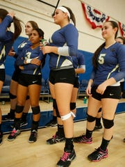 Ardsley's Nicolina Chenard (11) before the start volleyball match between Ardsley and Nanuet High School Section 1 Class B quarterfinal at Ardsley High School on Nov. 3, 2015.