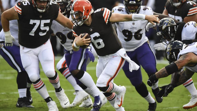 Cleveland Browns quarterback Baker Mayfield (6) scrambles in the backfield in the first half during an NFL football game against the Baltimore Ravens, Sunday, Sept. 13, 2020, in Baltimore.