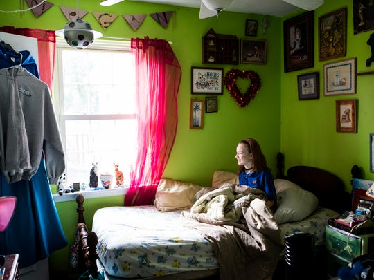 Emily Ruckle looks out the window as she sits in her half-sister Megan's bed on Thursday afternoon, September 20, 2016.