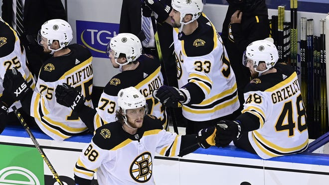 Boston Bruins right wing David Pastrnak (front) celebrates during the second period of an NHL Stanley Cup Eastern Conference playoff hockey game against the Tampa Bay Lightning on Sunday.
